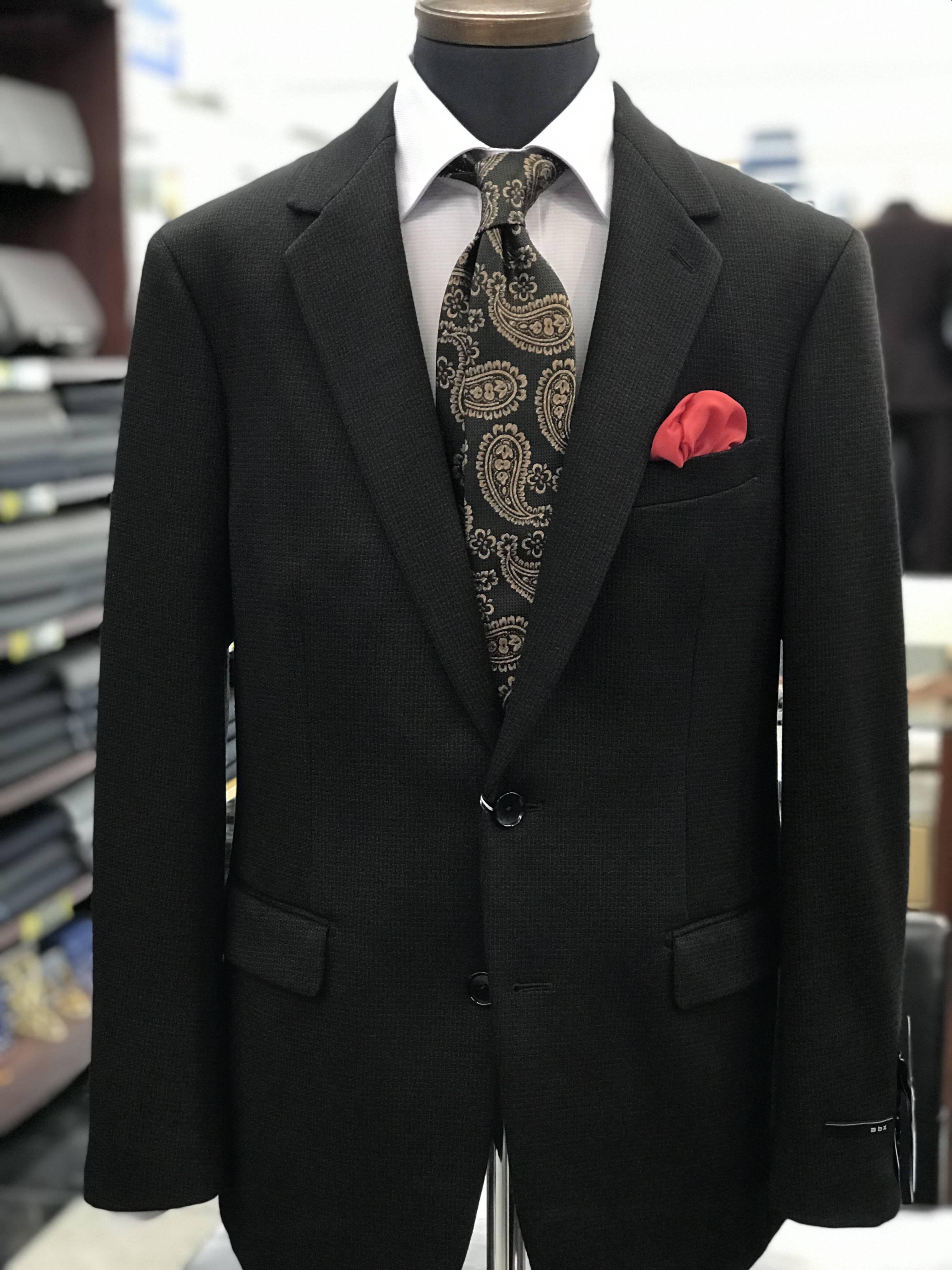 abxのニット生地スーツ